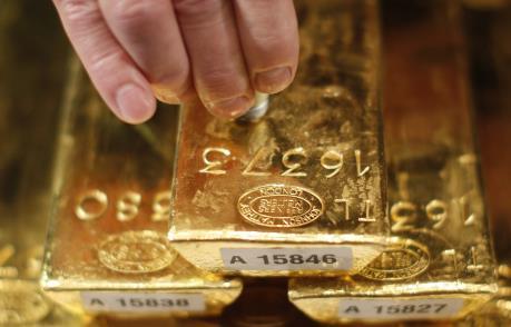 """Giá vàng châu Á chạm """"đáy"""" của một tháng"""
