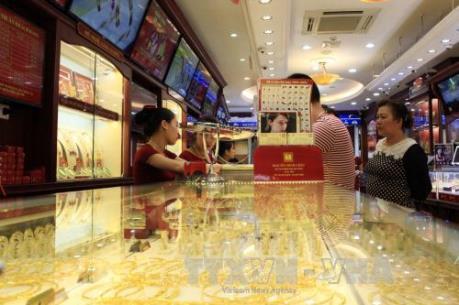 USD và chứng khoán toàn cầu đi xuống khiến vàng tăng giá