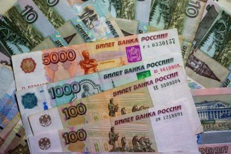 Đồng ruble Nga và đôla Canada mất giá mạnh