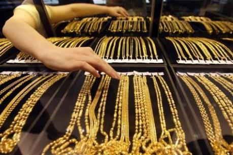 """Giá vàng châu Á rời """"đỉnh"""" của 9 tuần"""