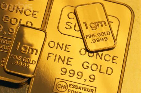 """Đồng USD mạnh kéo giá vàng xuống """"đáy"""" của một tháng"""