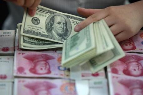 Trung Quốc ấn định tỷ giá tham chiếu đồng NDT thấp nhất kể từ năm 2011