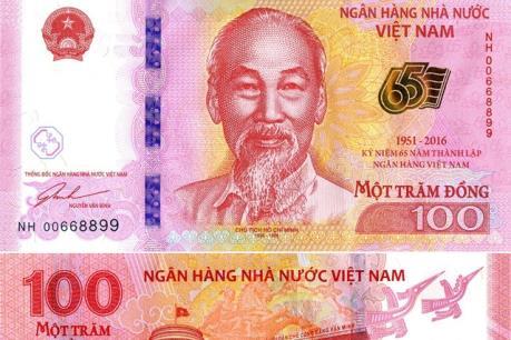 """Phát hành tiền lưu niệm """"Kỷ niệm 65 năm thành lập Ngân hàng Việt Nam"""""""