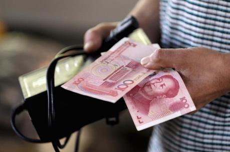 Đồng NDT tiếp tục suy yếu so với đồng USD