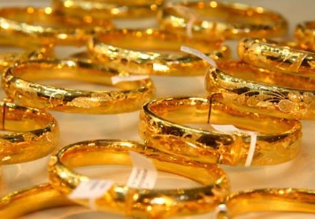 Vàng châu Á khép lại chuỗi tăng giá 4 phiên