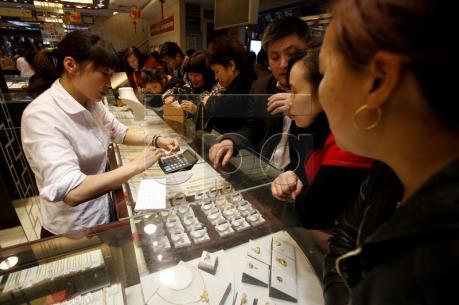 Thị trường vàng châu Á xuống giá trong phiên cuối tuần