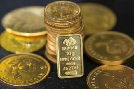 Đồng USD tăng cao, vàng bớt lấp lánh