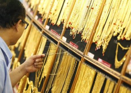 Giá vàng dịu xuống khi đồng USD tăng lên mức cao nhất trong 14 năm