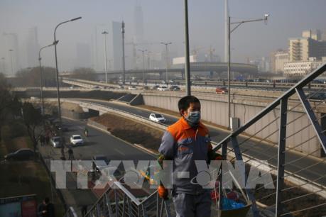 """Trung Quốc: Thủ đô Bắc Kinh tiếp tục ban bố cảnh báo """"cam"""" do ô nhiễm không khí"""