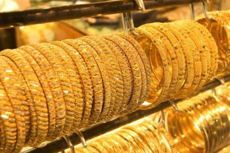 Giá vàng châu Á đi xuống sau hàm ý tăng lãi suất của Chủ tịch Fed