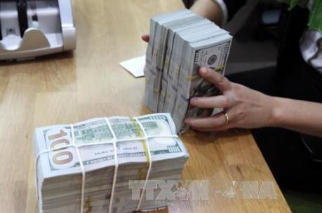 Ngân hàng Nhà nước trả lời về lãi suất gửi và huy động nguồn lực từ USD