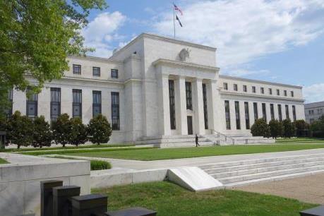 Fed giữ nguyên lãi suất và kết thúc chương trình kích thích kinh tế