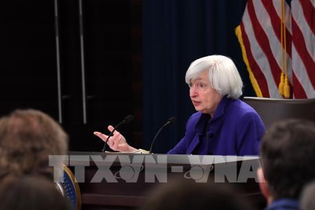 Fed tăng lãi suất cơ bản và dự kiến sẽ tăng thêm 3 lần nữa năm tới