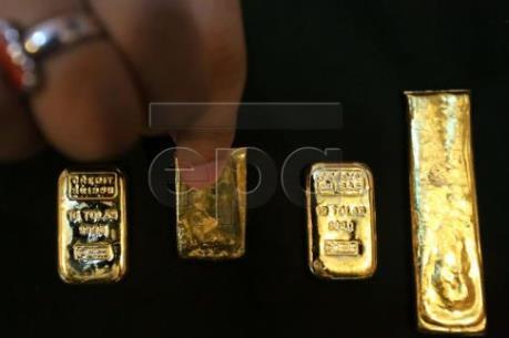 Giá vàng châu Á giảm giá phiên thứ ba liên tiếp