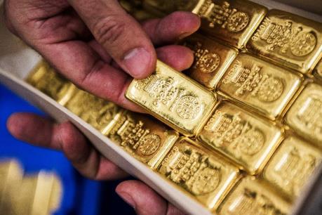 Giá vàng thế giới giảm sau khi Mỹ điều chỉnh số liệu tăng trưởng quý IV/2017