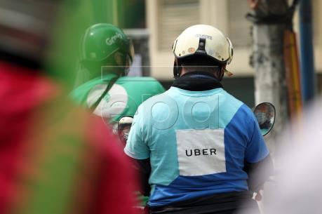 Vụ Grab mua quyền hoạt động Uber: Cạnh tranh để tồn tại