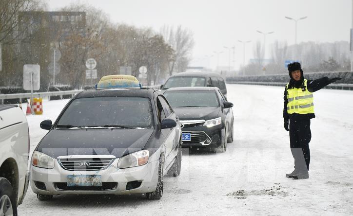 Tuyết rơi gây thiệt hại lớn ở Trung Quốc - hình 4