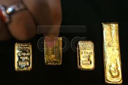 Giá vàng thế giới 6/12 giảm khi đồng USD phục hồi