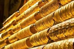 """Giá vàng thế giới rời khỏi mức """"đỉnh"""" của tám tuần"""