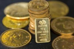 Giá vàng châu Á đi xuống khi đồng USD phục hồi