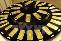 Giá vàng thế giới ngày 21/9 giảm xuống dưới 1.300 USD/ounce