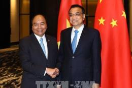 Hội nghị Cấp cao ASEAN 31: Thủ tướng Nguyễn Xuân Phúc hội kiến Thủ tướng Trung Quốc