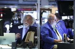 Chứng khoán Phố Wall đảo chiều đi lên sau nhận định của Chủ tịch Fed