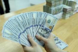 Tỷ giá trung tâm giảm 2 đồng, giá đồng bảng Anh và Nhân dân tệ giảm
