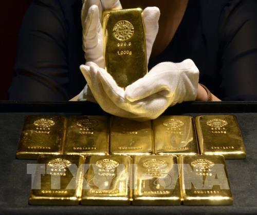 giá vàng rời khỏi mức đỉnh của sáu tháng rưỡi qua