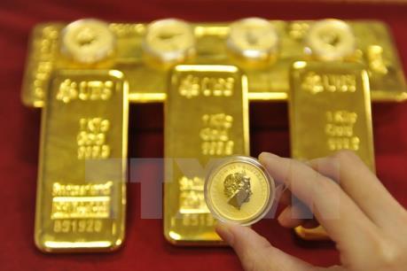 Giá vàng châu Á trượt dốc do đồng USD phục hồi