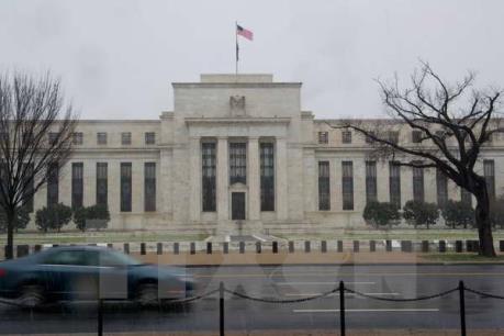 """Báo cáo khả quan về thị trường việc làm Mỹ """"dọn đường"""" để Fed nâng lãi suất vào tuần tới"""