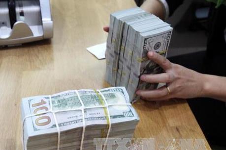 Đồng USD tiến sát mốc 112 yen