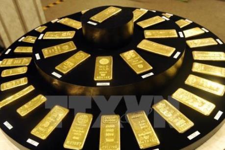 """Vàng bớt """"lung linh"""" trên thị trường thế giới"""