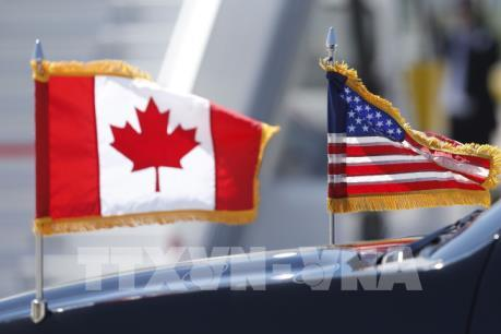 Mỹ và Canada giải quyết được mâu thuẫn về thị trường sữa và thuế ô tô
