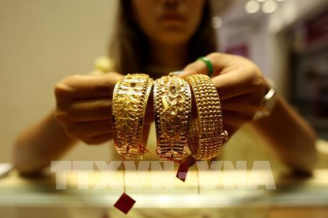Chứng khoán toàn cầu tăng mạnh gây sức ép lên giá vàng