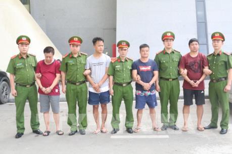 Công an Việt Nam bàn giao tội phạm truy nã cho Trung Quốc