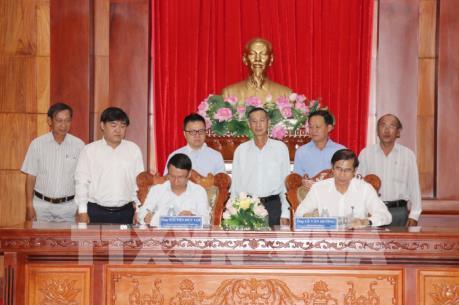 Hợp tác thông tin giữa TTXVN và UBND tỉnh Tiền Giang
