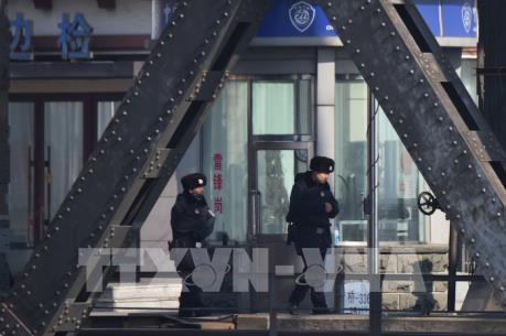 Dịch COVID-19: Cảnh sát Trung Quốc xử lý hàng trăm đối tượng trục lợi
