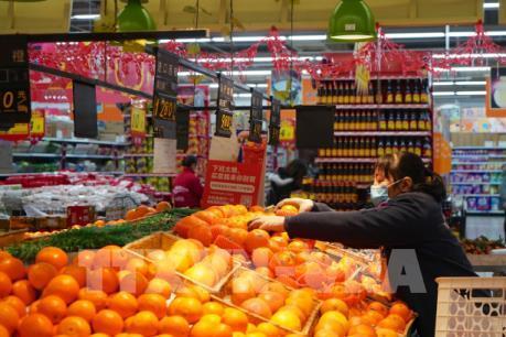 Dịch COVID-19: Nhiều cửa hàng, siêu thị của Trung Quốc trở lại hoạt động