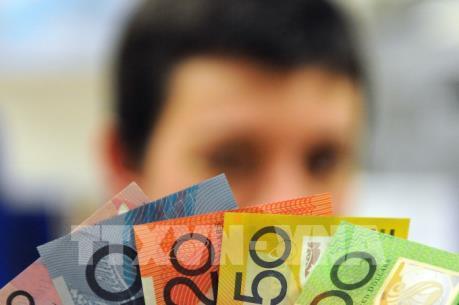 Dịch COVID-19: Đồng nội tệ Australia trượt giá kỷ lục