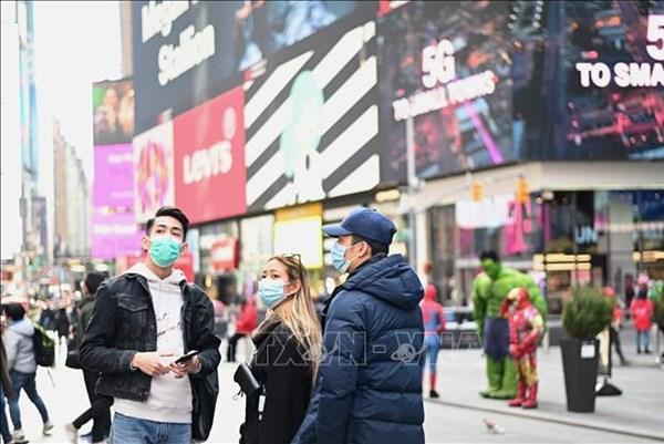 WHO khuyến khích dùng khẩu trang để hạn chế sự lây lan virus