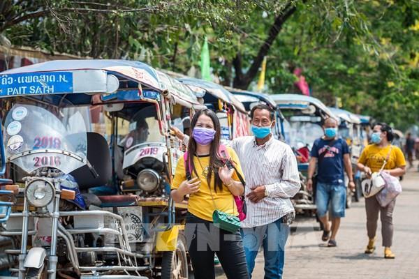 Người nước ngoài tại Lào tạm thời không phải xin gia hạn lưu trú nếu hết hạn thị thực
