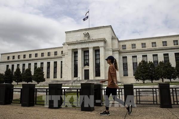 Fed giữ nguyên lãi suất cho đến khi kinh tế chuyển biến thuận lợi