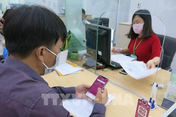 Bình Dương: Thanh toán không dùng tiền mặt khi giải quyết thủ tục hành chính công