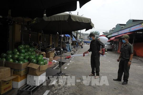 Nhiều biện pháp phòng, chống COVID-19 tại chợ đầu mối lớn nhất Thủ đô