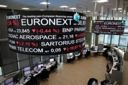 Phố Wall biến động trái chiều với các thị trường chứng khoán châu Âu