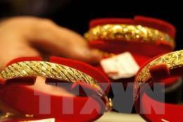 Giá vàng châu Á đảo chiều giảm nhẹ trong phiên cuối tuần